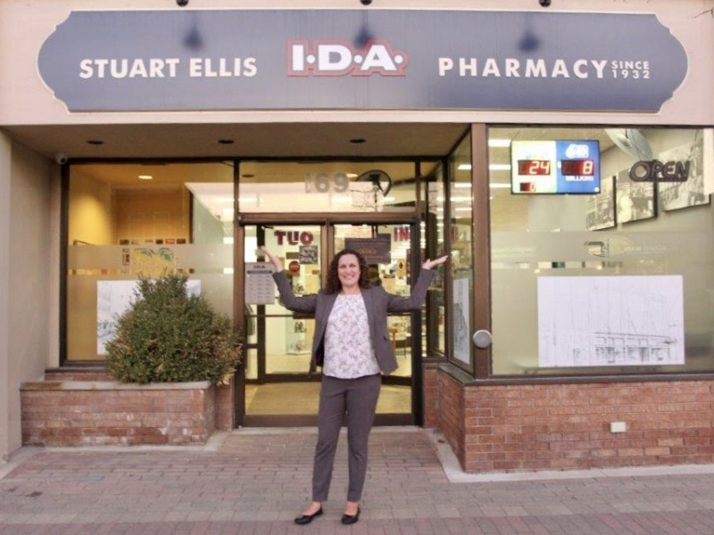 Melissa in front of pharmacy